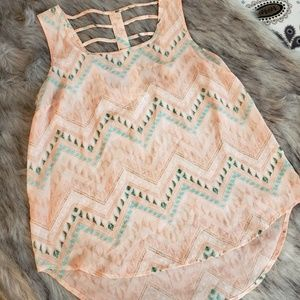 Tank/blouse with beautiful back detail.